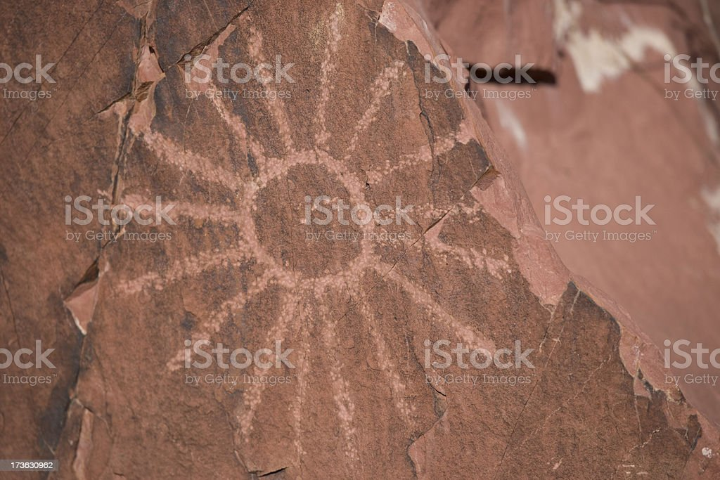 Petroglyph Sun stock photo