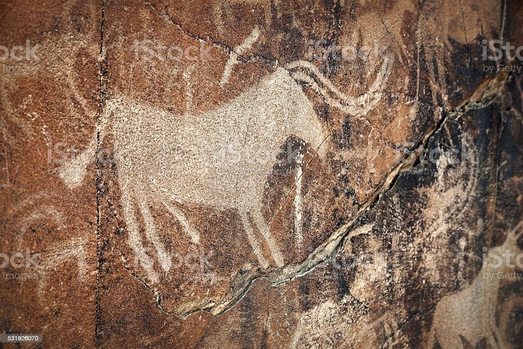 Petroglyph with animals on the rock stock photo