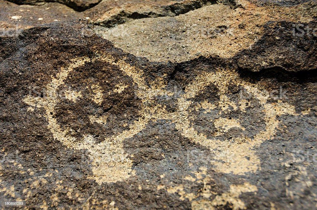 Petroglyphs on Basalt in Petroglyph National Monument, Albuquerq royalty-free stock photo