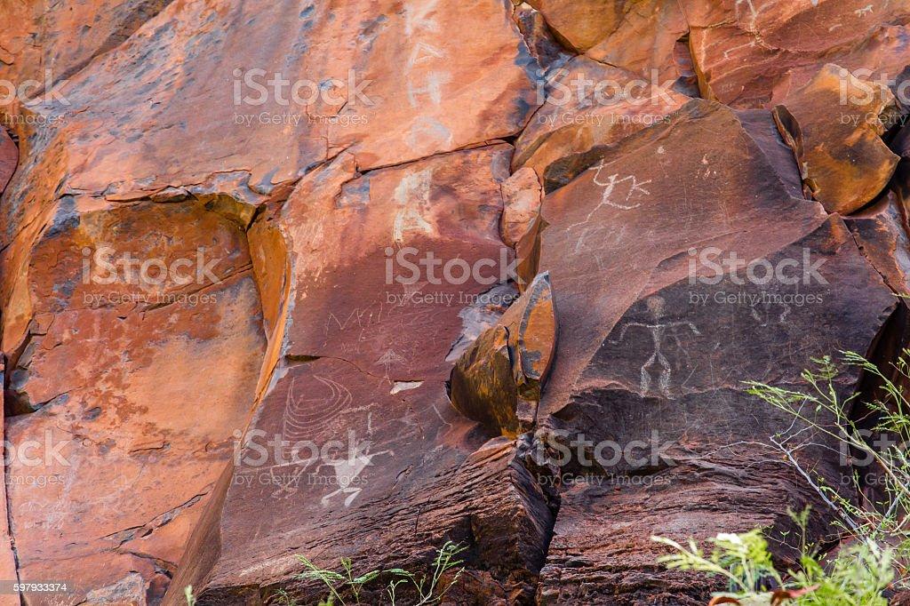 petroglyphs on rocks stock photo