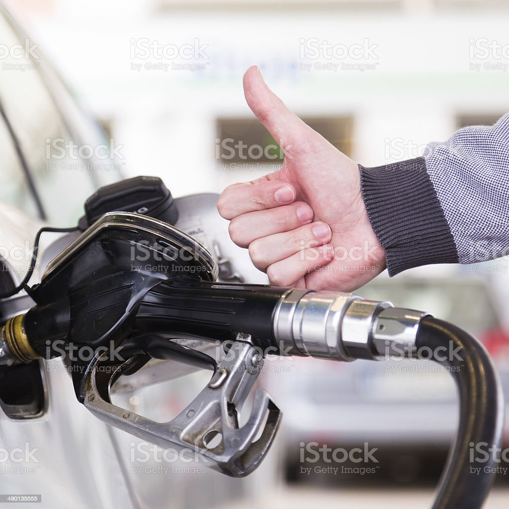 Petrol being pumped into a motor vehicle car. stock photo