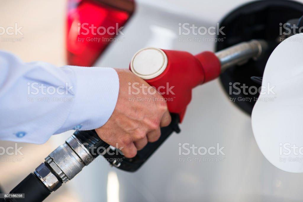 petrol gun in the hands of men stock photo