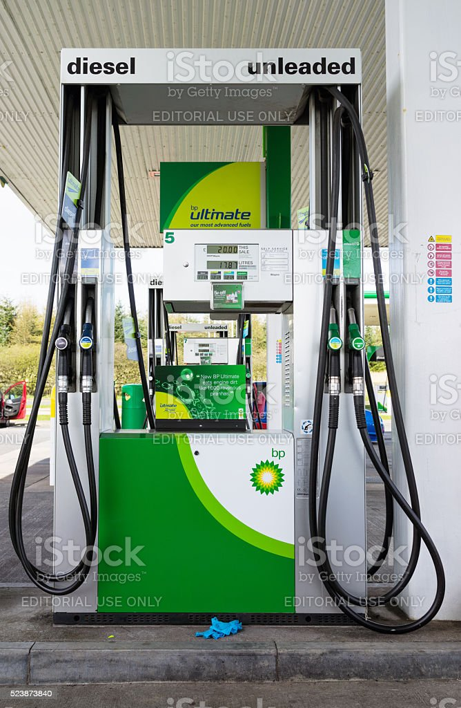 BP Petrol pumps on garage forecourt stock photo