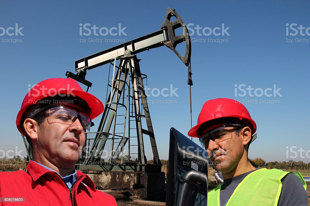 Petroleum Engineers Looking at Laptop Computer stock photo