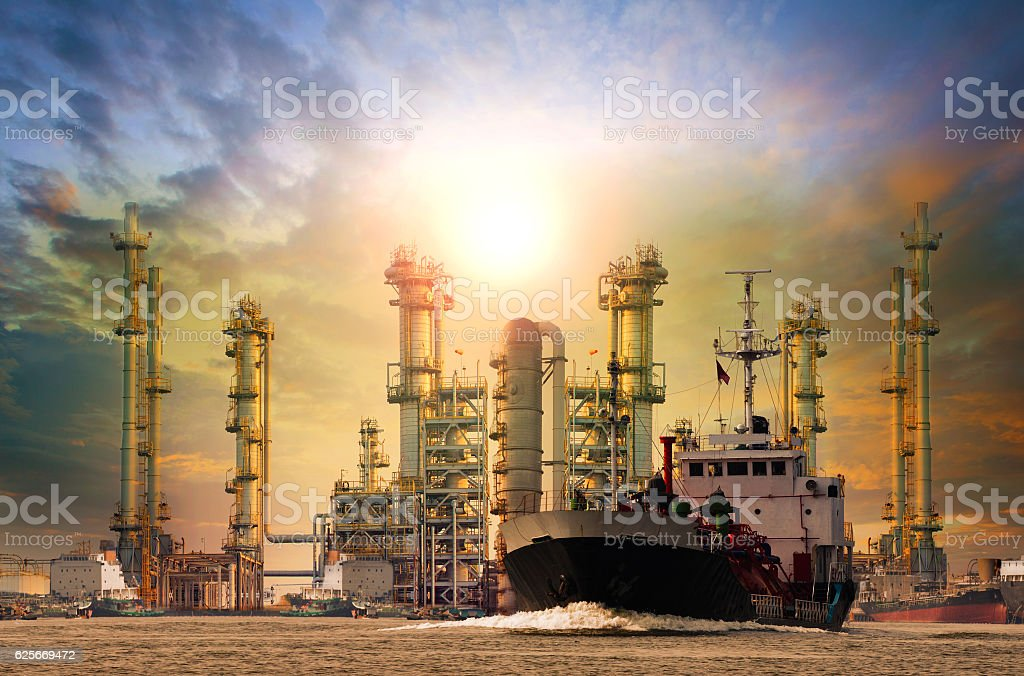 petroleum gas container ship and oil refinery background for ene stock photo