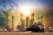 petroleum gas container ship and oil refinery background for ene