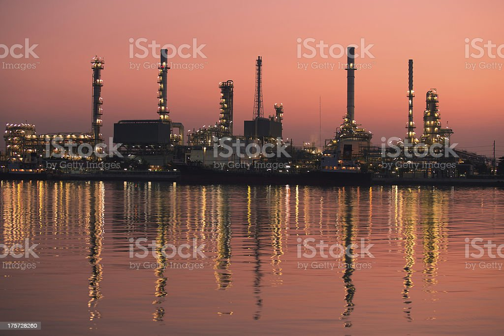 Petroleum oil refinery beside the river at sunrise royalty-free stock photo
