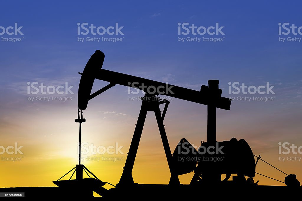 Petroleum pump in the desert at sunset royalty-free stock photo