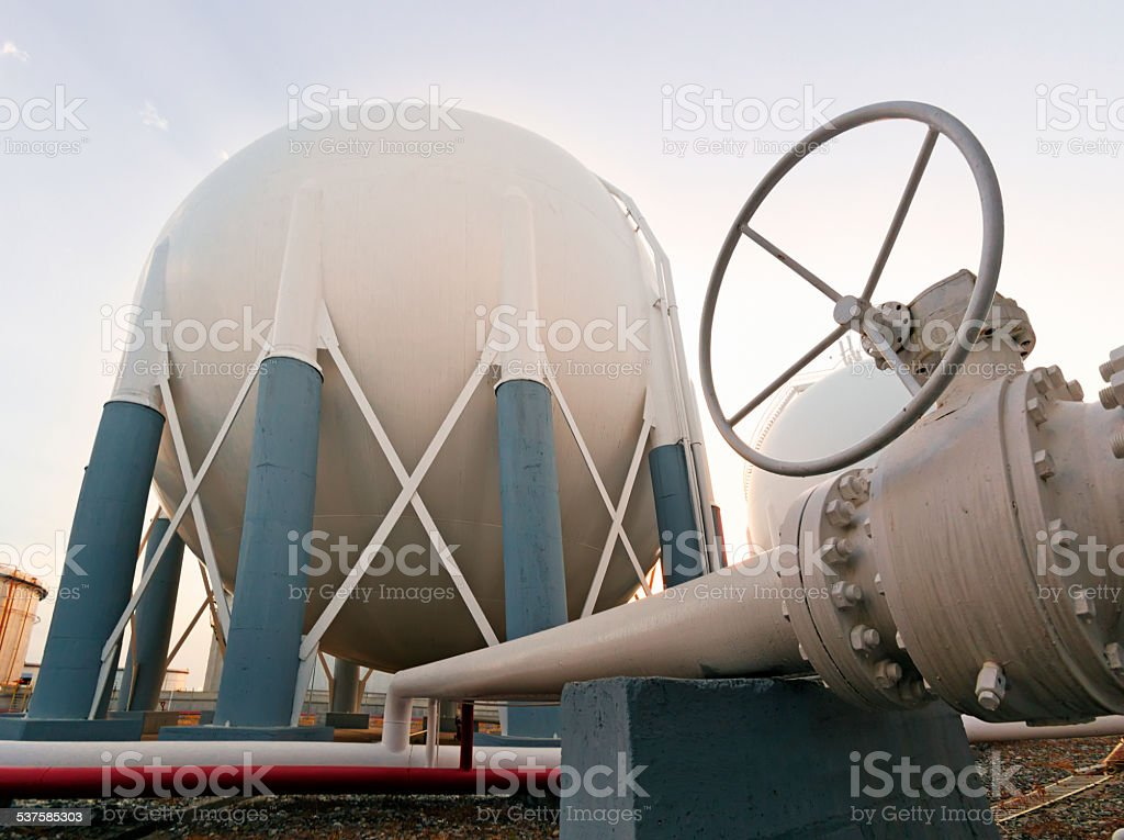 Petroleum Storage Tank on Petrochemical Plant and valves stock photo