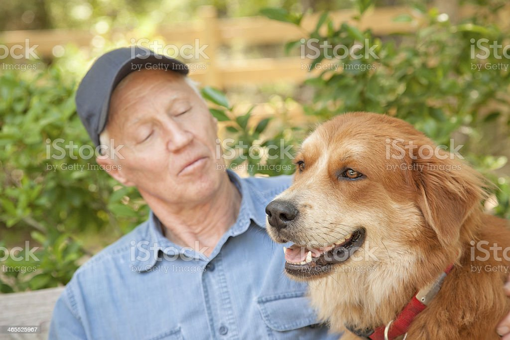 Pets: Senior man outside with his pet dog. royalty-free stock photo