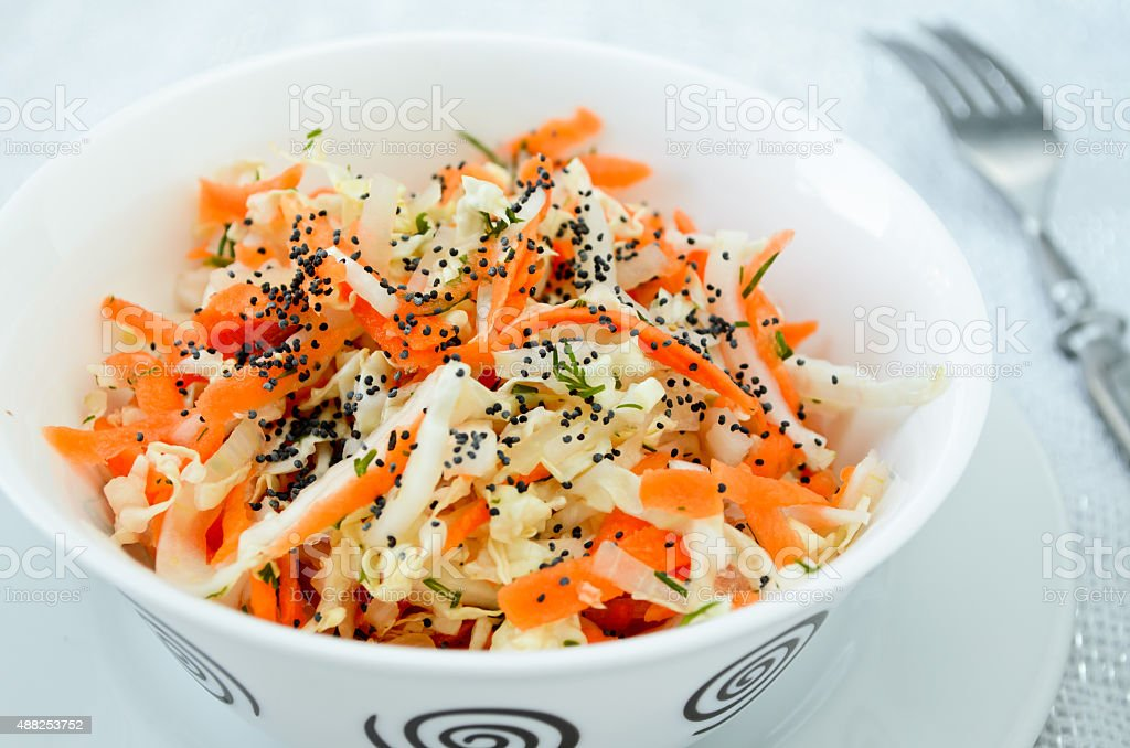 pe-tsai cabbage salad with carrot, dill and poppy seed stock photo