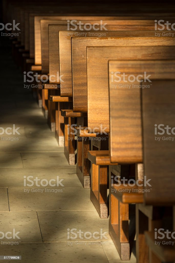 Pews in the morning light. stock photo