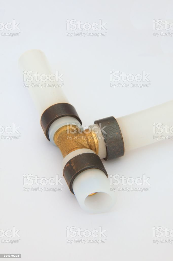 Pex pipe fitting, on a tee connector, plastic pipe stock photo