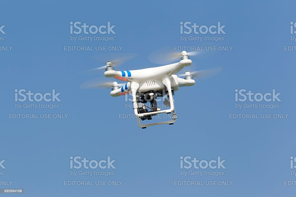 DJI Phantom drone in flight with a mounted GoPro Hero3 stock photo