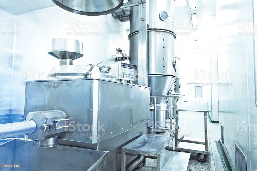 pharmaceutical factory equipment working stock photo