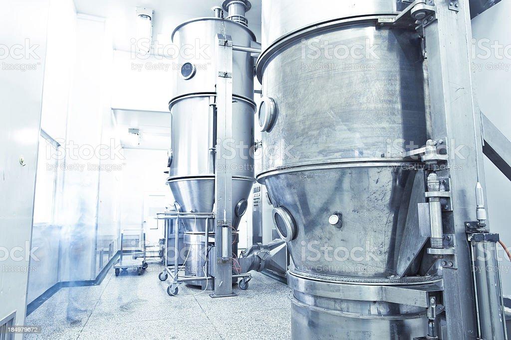 pharmaceutical factory equipment working stock photo