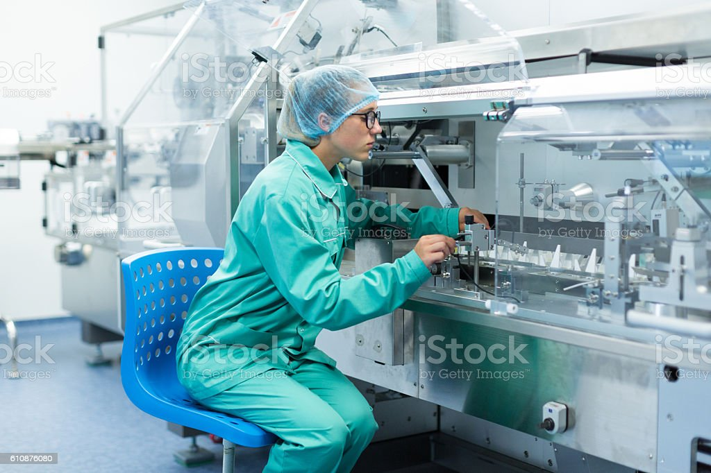 pharmaceutical factory worker at the workplace stock photo