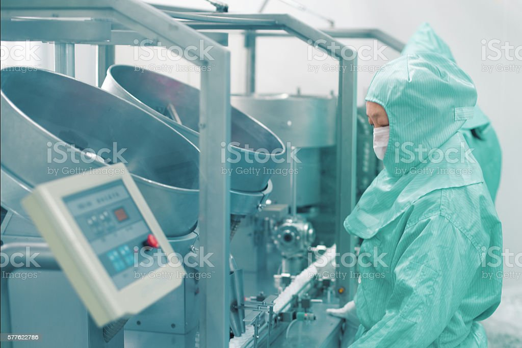 pharmaceutical factory worker stock photo