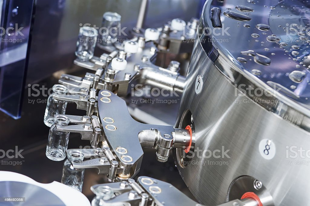 pharmaceutical machine for powder drugs glassware bottles stock photo