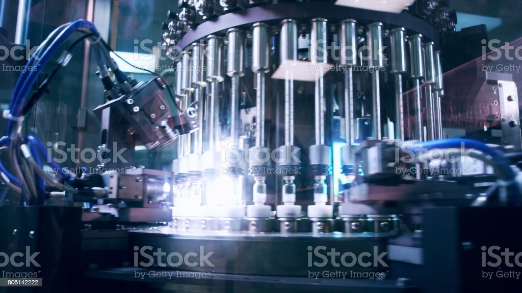 Pharmaceutical manufacturing line at factory. Pharmaceutical quality control stock photo