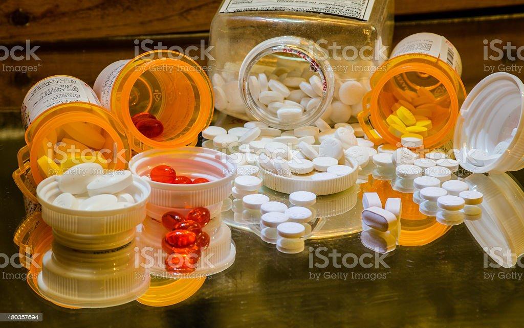 Pharmaceutical War on Drugs Pills Bottles Spilled on Mirror stock photo
