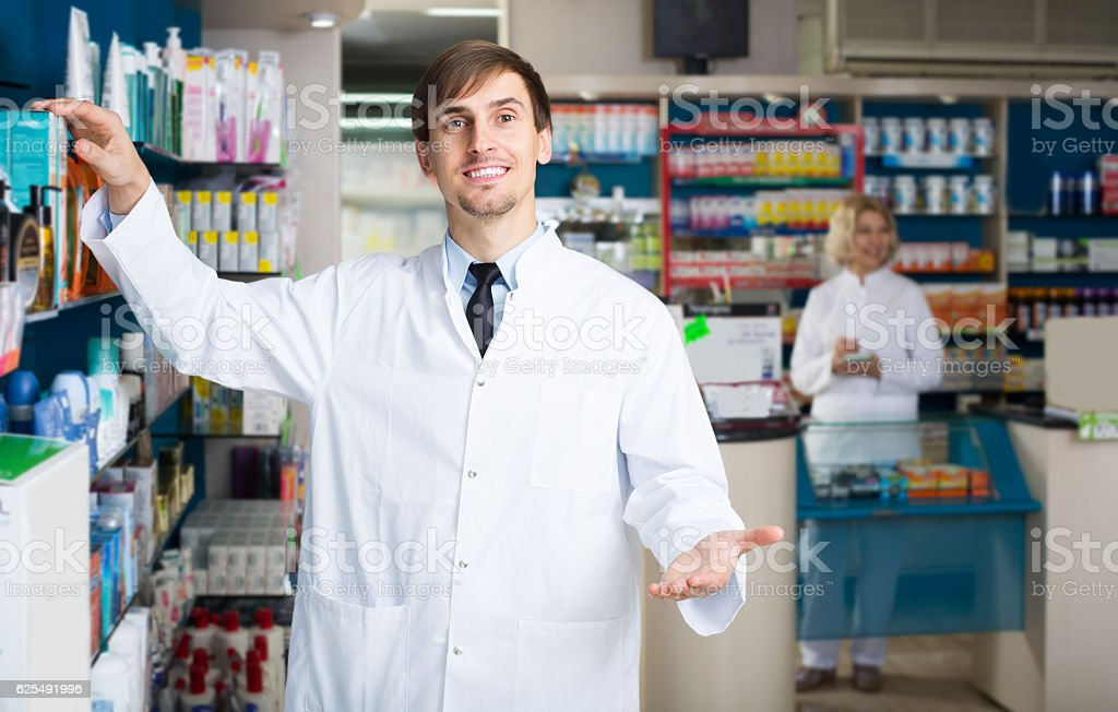 pharmaceutists working in chemist shop stock photo