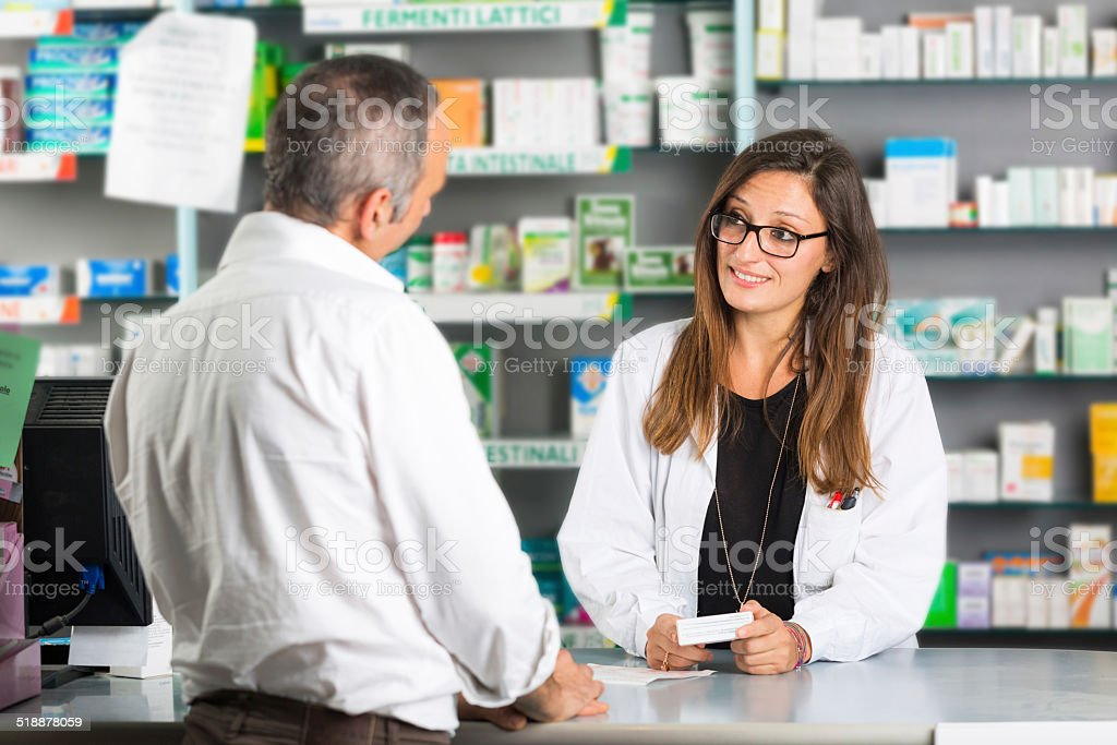Pharmacist and Client in a Drugstore stock photo