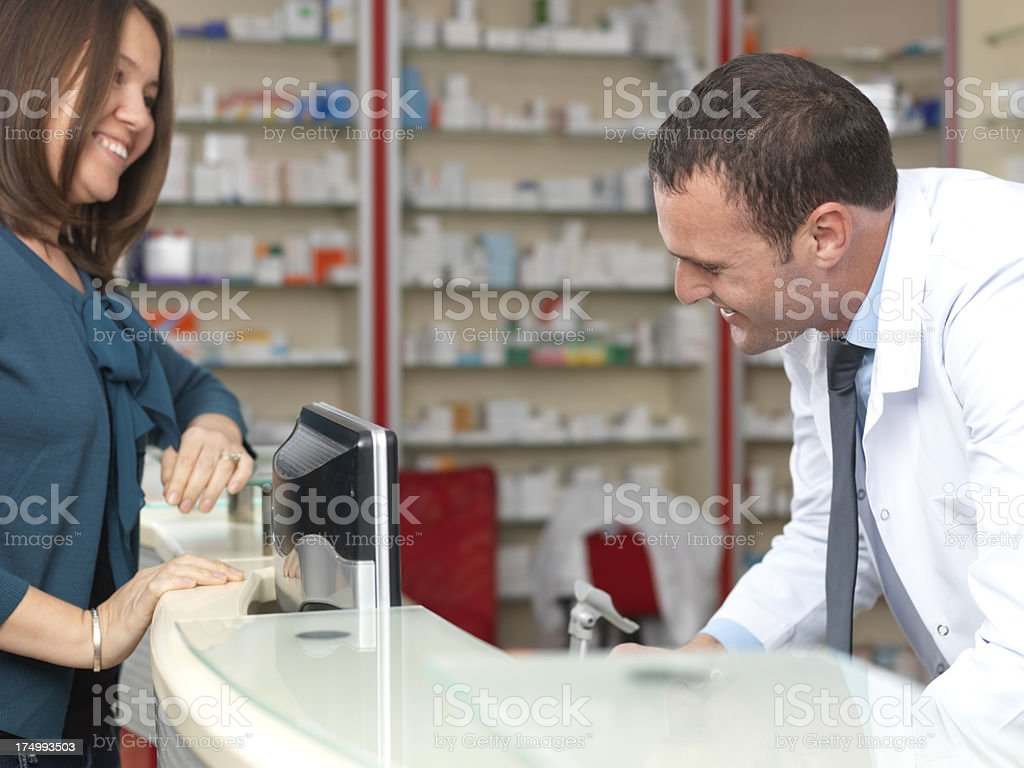Pharmacist and Customer stock photo