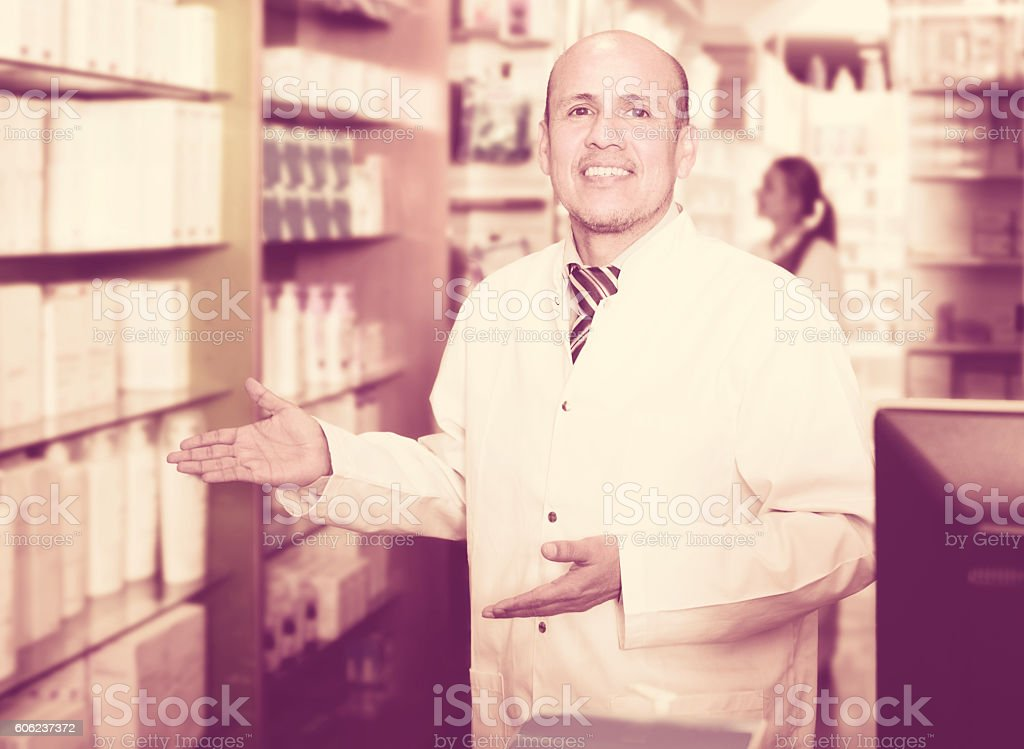 Pharmacist and pharmacy technician posing in modern farmacy stock photo