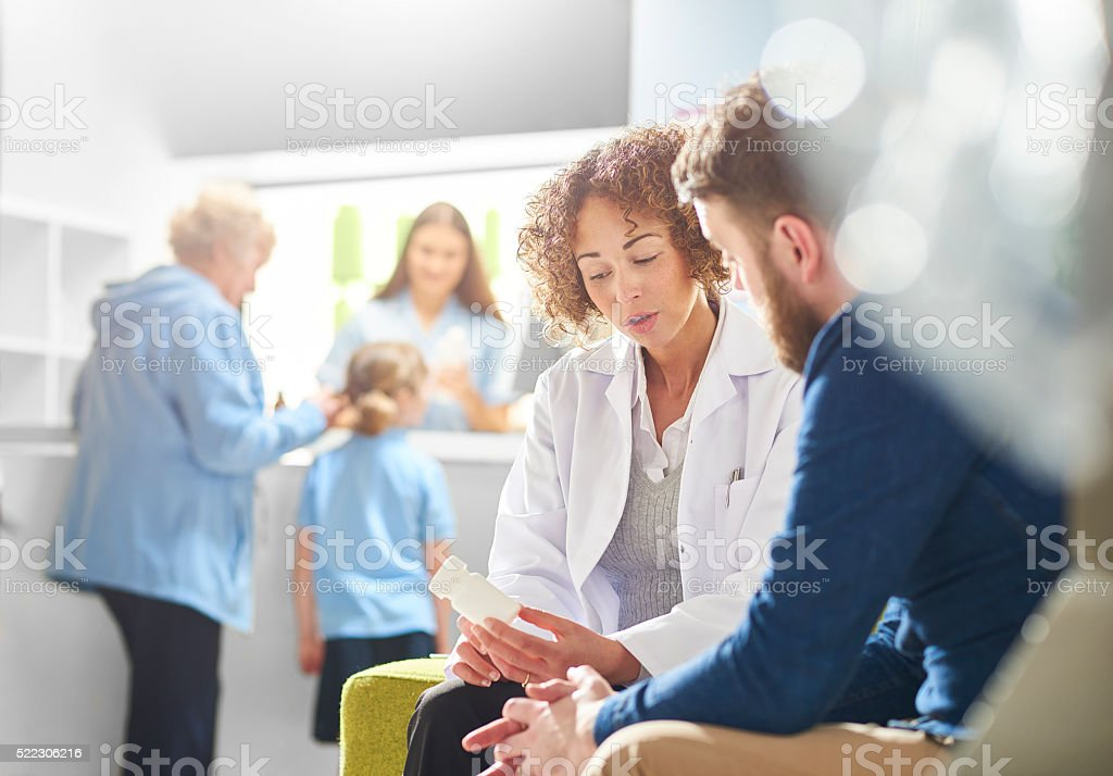 pharmacist consultation with customer stock photo