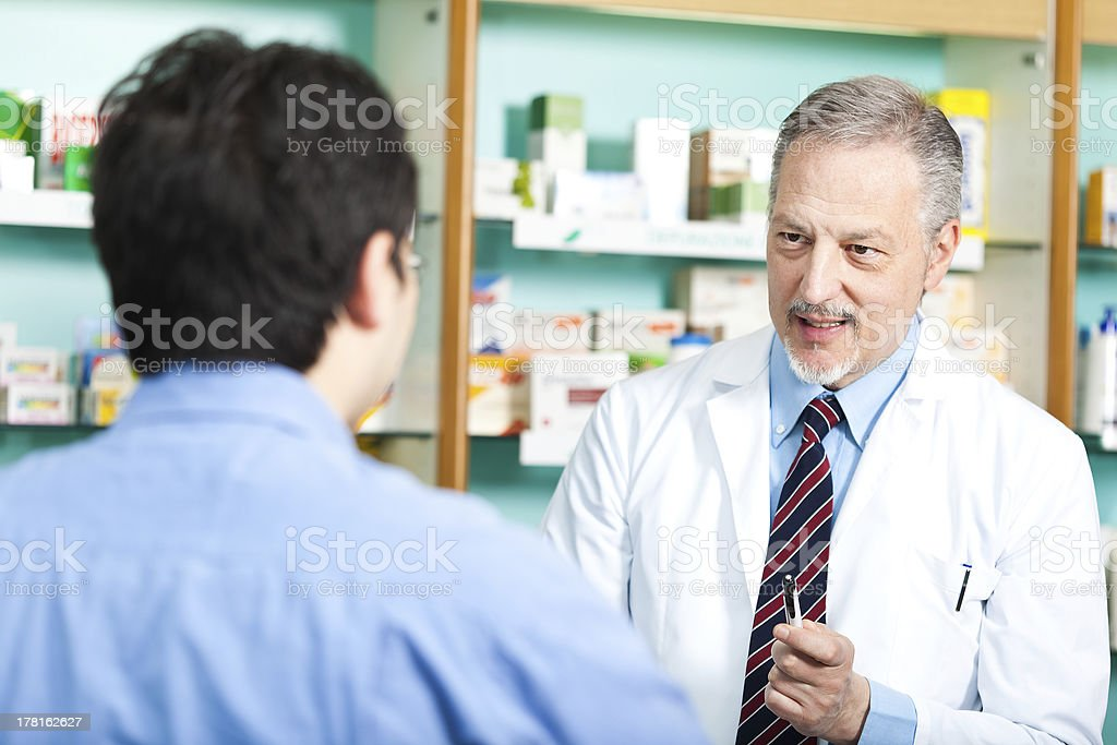 Pharmacist dealing with a customer stock photo