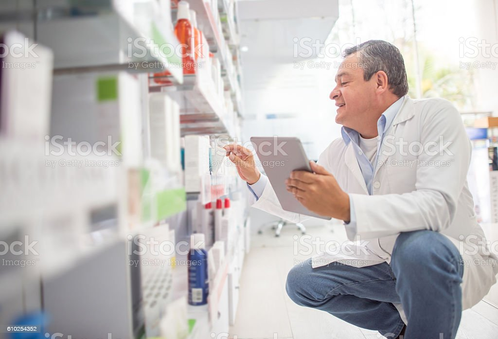 Pharmacist doing the inventory at a drugstore stock photo