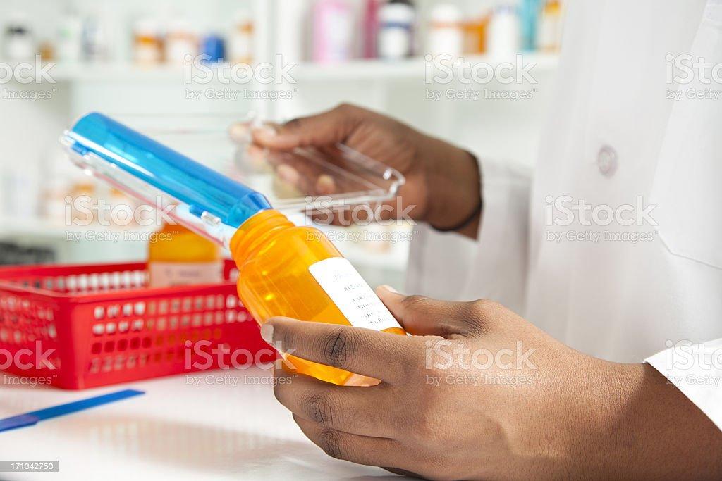 Pharmacist filling bottle for a prescription stock photo