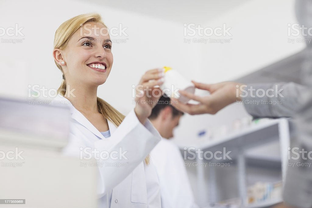 Pharmacist giving drug box to patient royalty-free stock photo