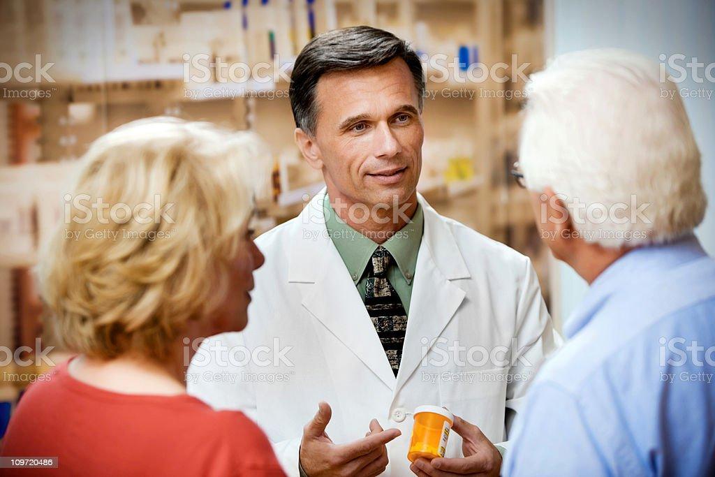 Pharmacist holding Prescription Bottle stock photo