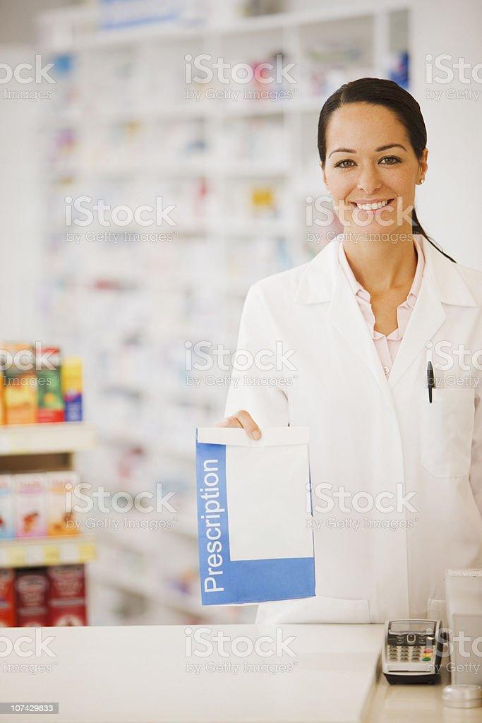 Pharmacist holding prescription in drug store royalty-free stock photo