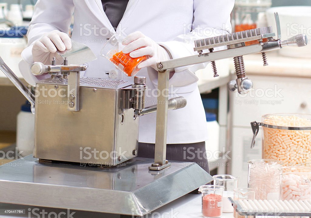 Pharmacist holding tube in a lab stock photo