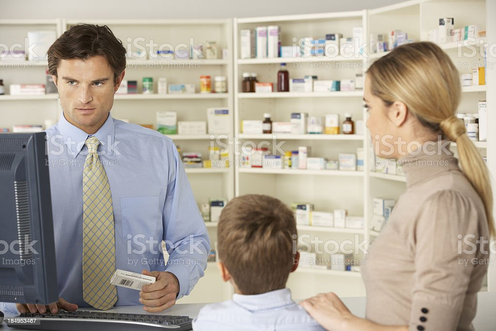 Pharmacist in pharmacy with mother and child royalty-free stock photo