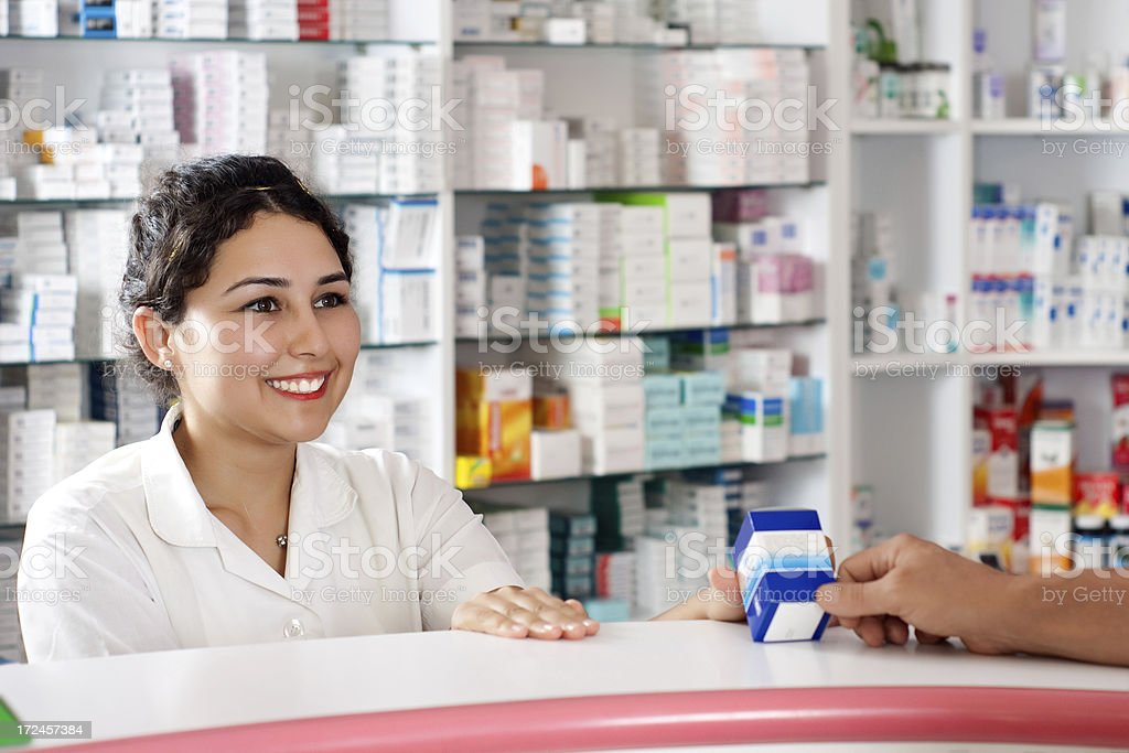 Pharmacist is talking with customer royalty-free stock photo