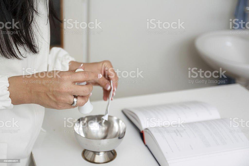 Pharmacist prepare mixture in mortar royalty-free stock photo