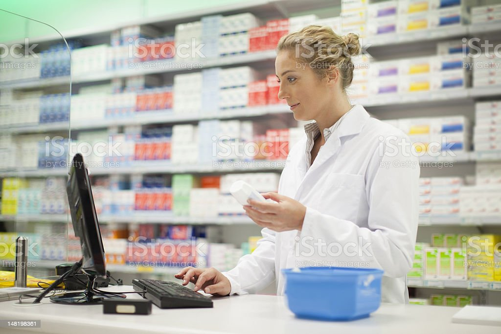 Pharmacist researching medication stock photo