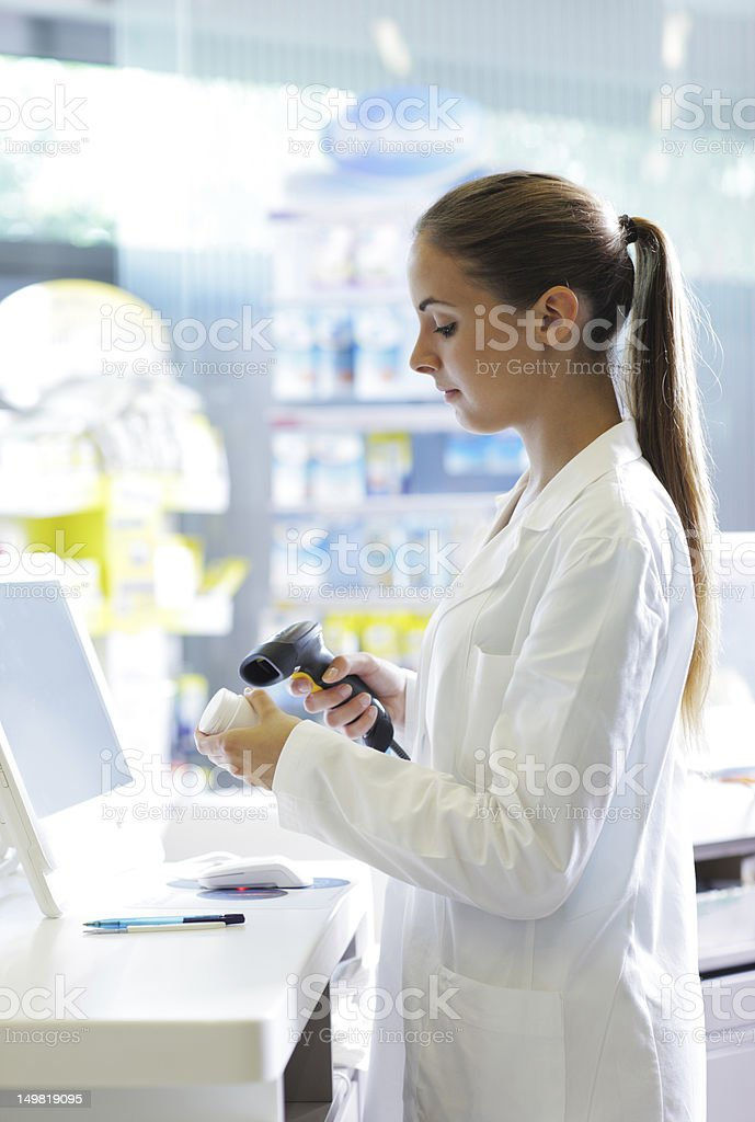 Pharmacist scanning a pill bottle stock photo