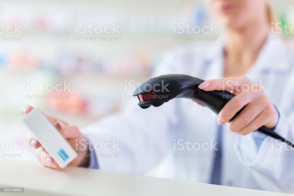 Pharmacist scanning product stock photo