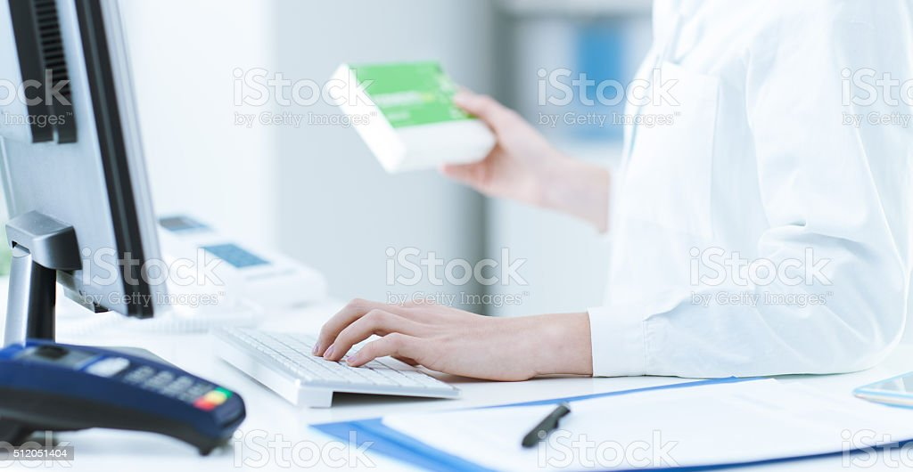 Pharmacist searching products in the database stock photo