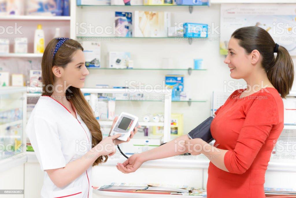 Pharmacist showing a tonometer stock photo