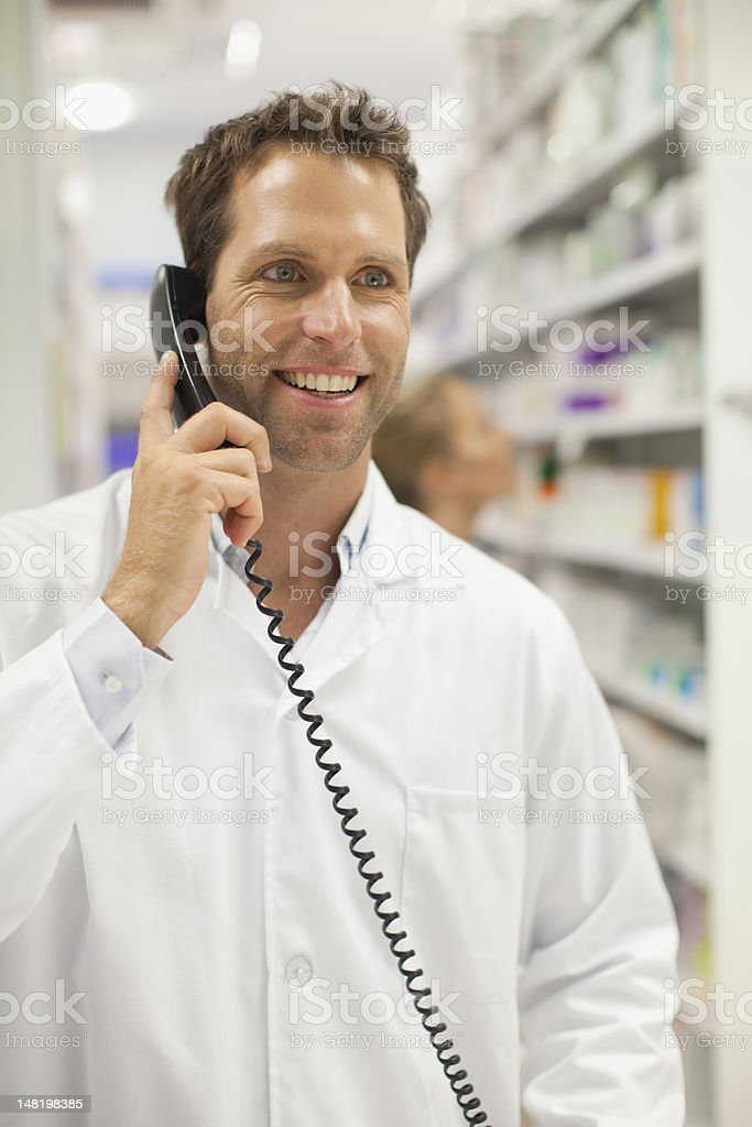 Pharmacist talking on phone royalty-free stock photo