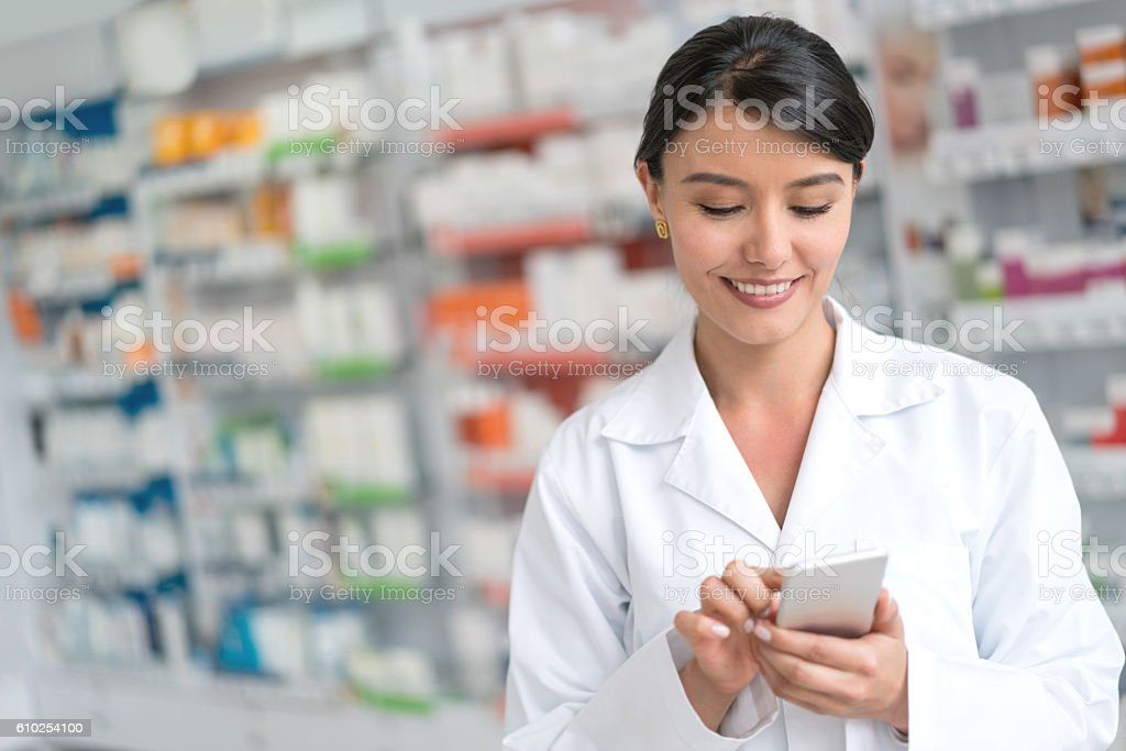 Pharmacist using app on a smart phone stock photo