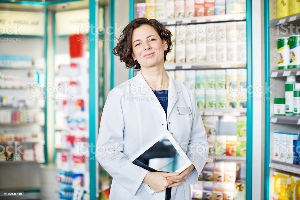 Pharmacist with digital tablet in a chemist store stock photo