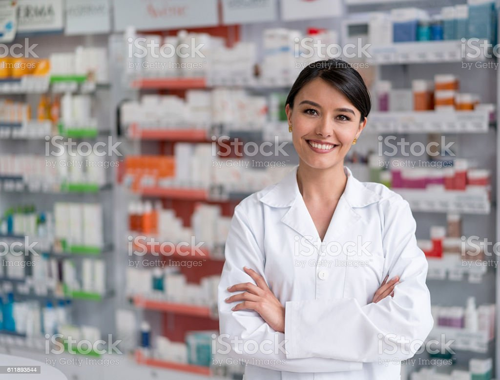 Pharmacist working at the drugstore stock photo