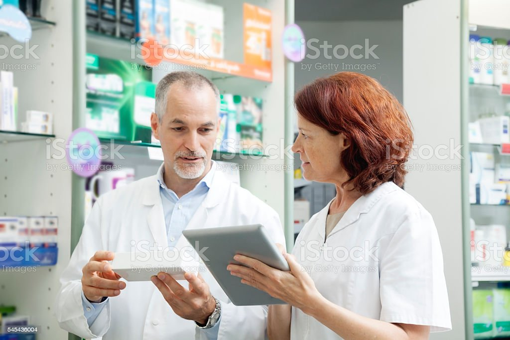 Pharmacists at work stock photo